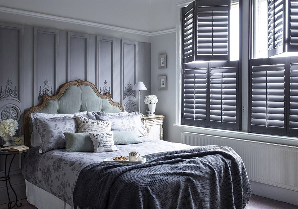 89mm tier on tier shutters in a period bedroom.