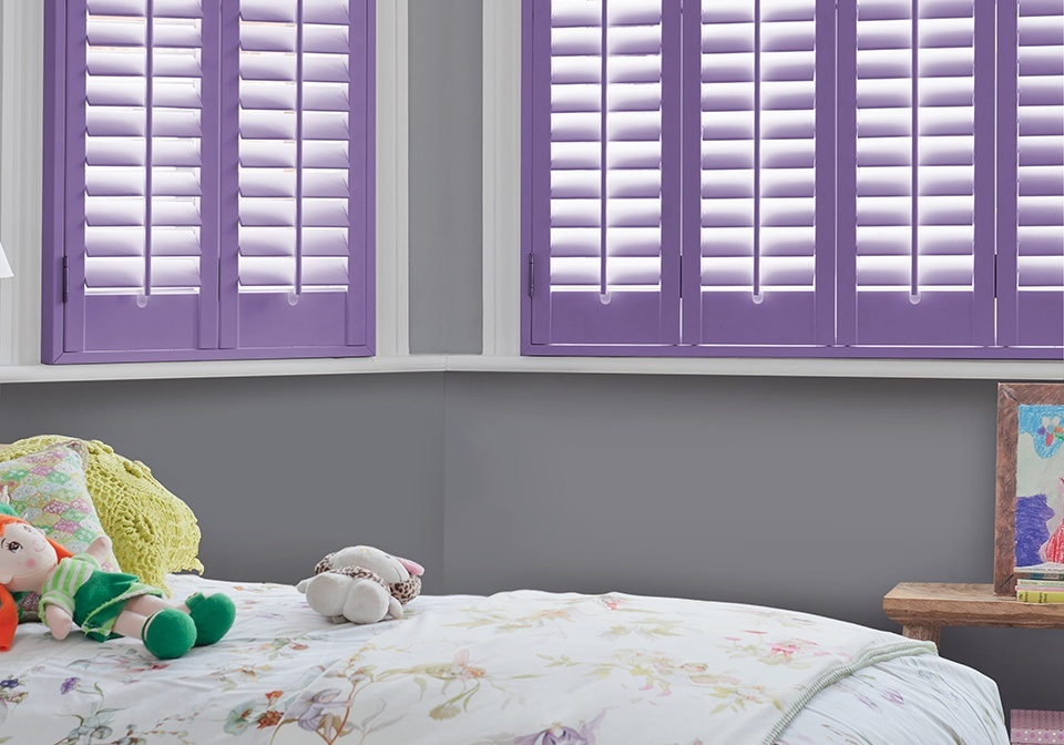 Custom coloured full height shutters in a child's bedroom.
