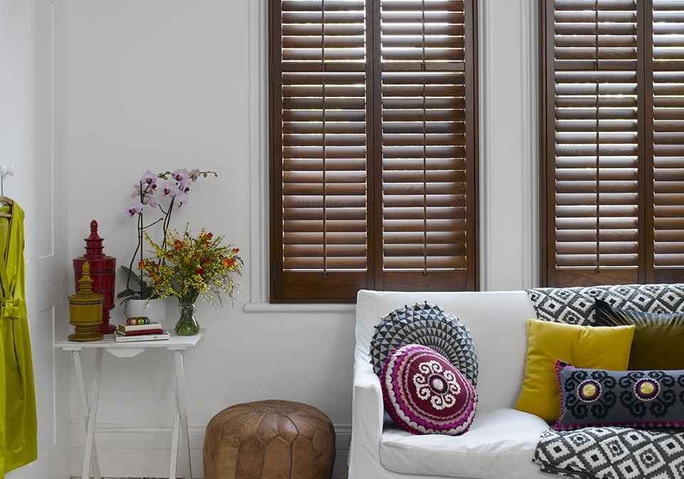 Luxurious dark stained wood shutters with 64mm slats