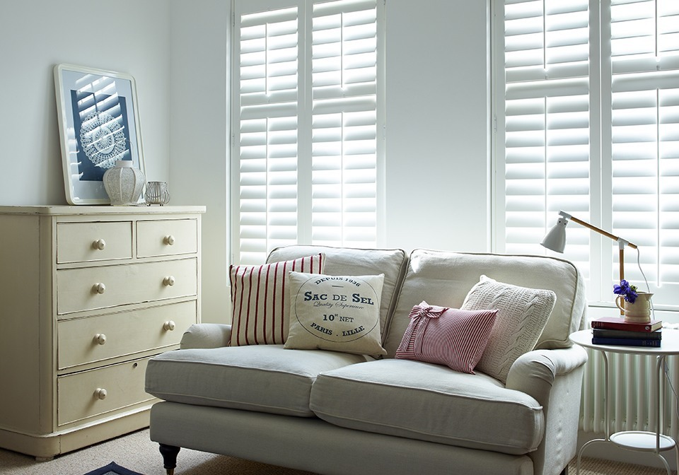 Subtle bright white shutters fitted inside the recess