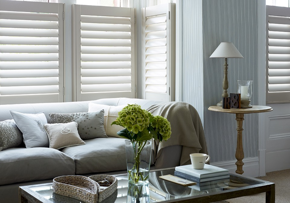 Lounge café style shutters finished in an off white paint.