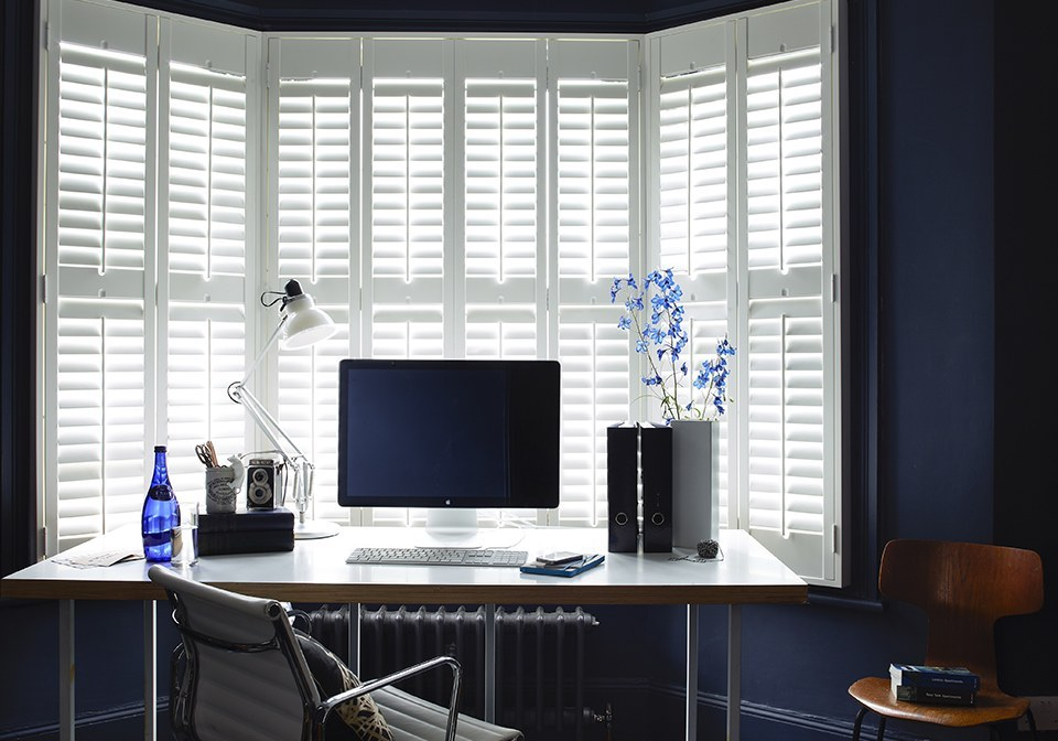Pure White finished shutters with 64mm slats in a bay window.